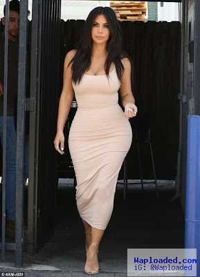 Photos: Kim Kardashian shows off her body in figure sexy outfit